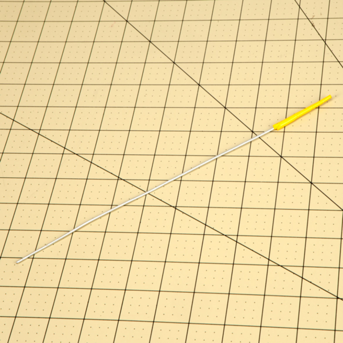Triangle from previous step rolled onto a thick piece of wire so that the tape tapers off at the tip