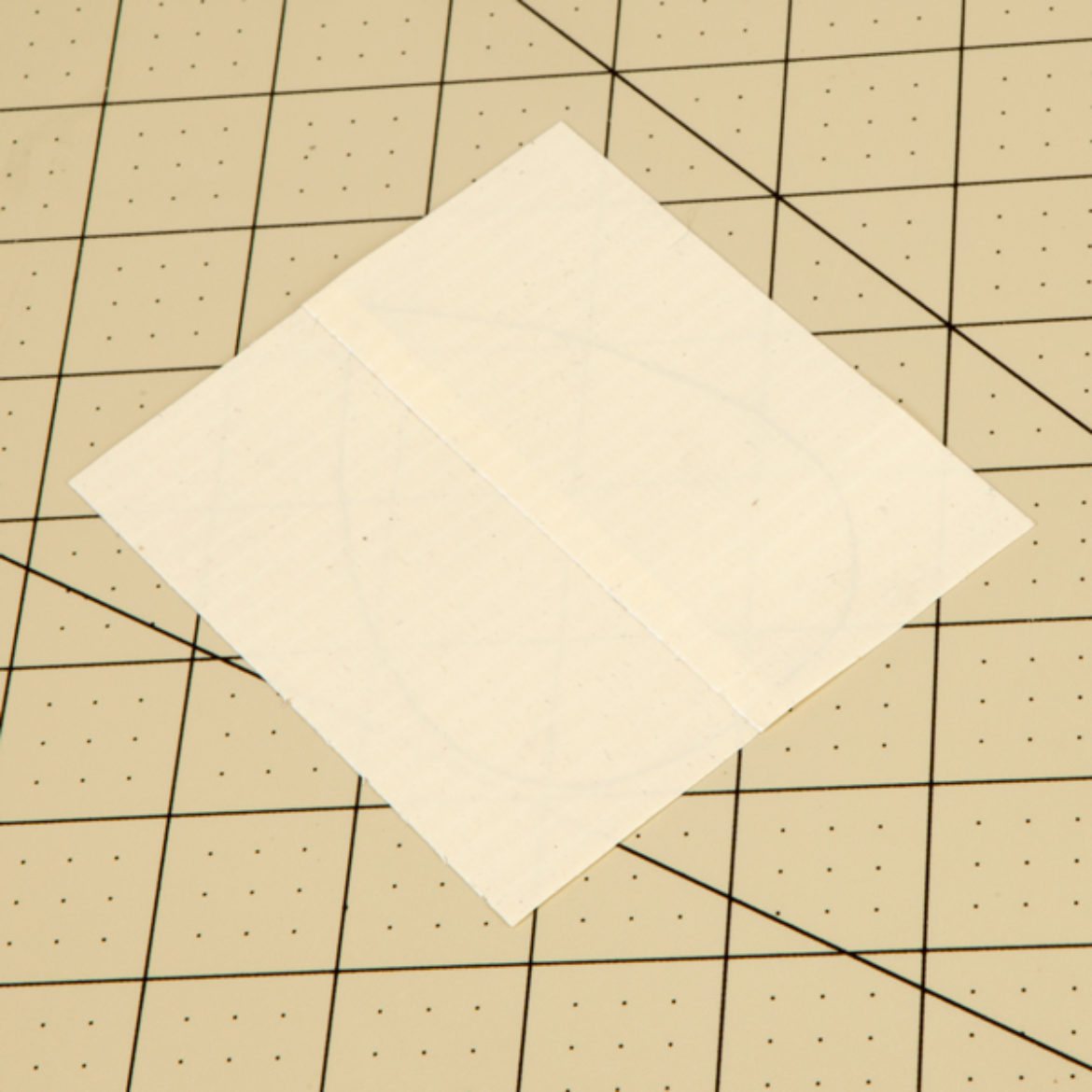 Two pieces of tape overlapped to make a square of Duck Tape