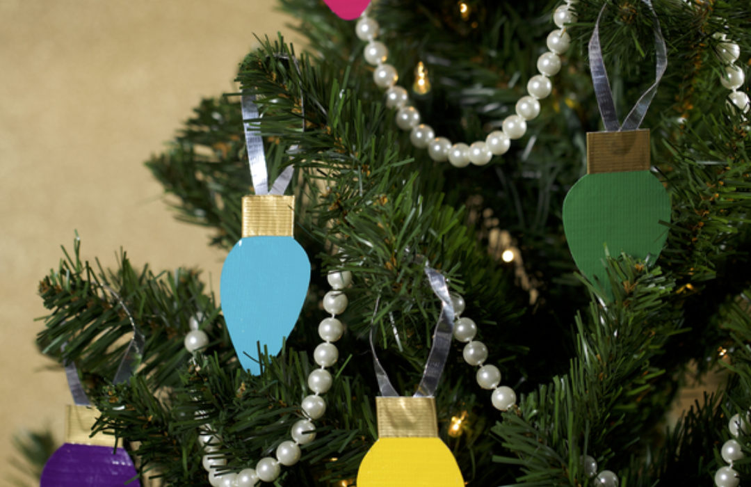 Completed  Duck Tape®Christmas Light Tree Décor hanging on a tree