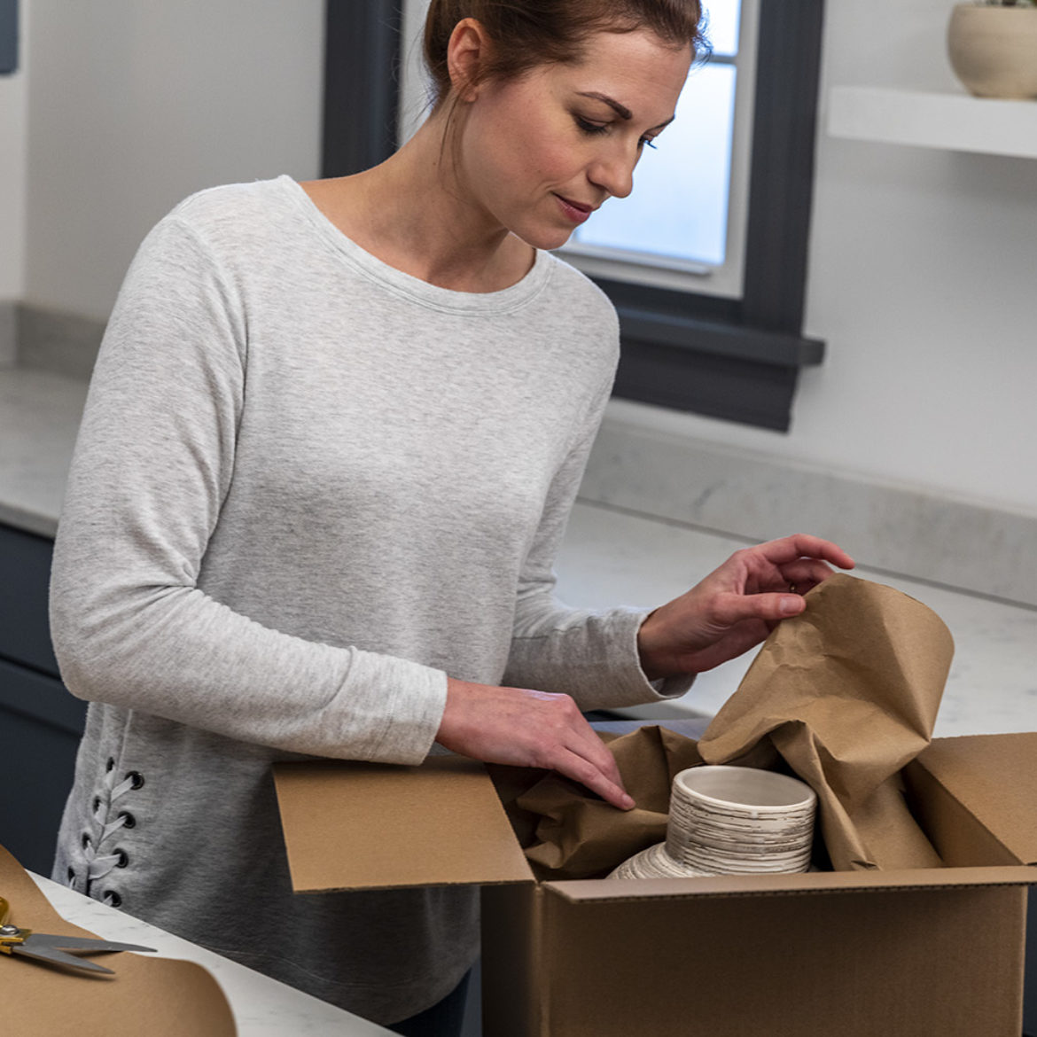 Woman packing a box
