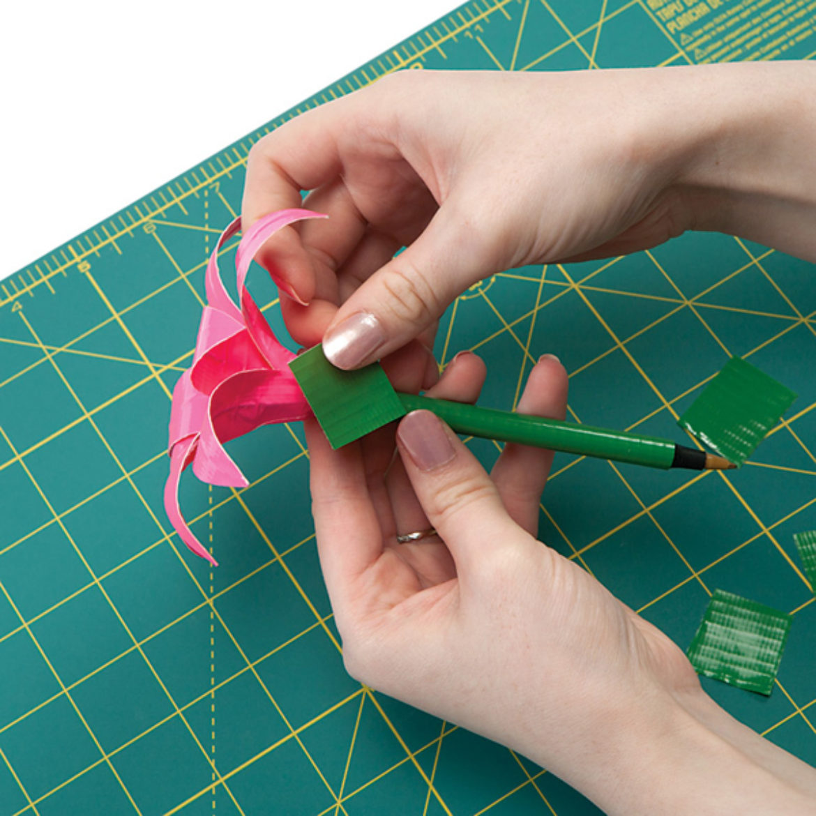 small strips of Duck Tape wrapped around the base of the flower where the petals are taped to the pen