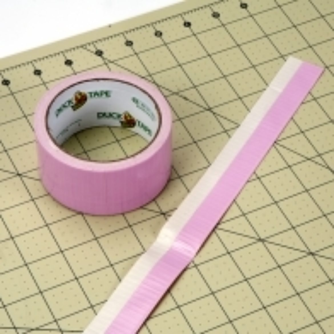 Strip of pink Duck Tape folded over itself length wise 1/3 of the way