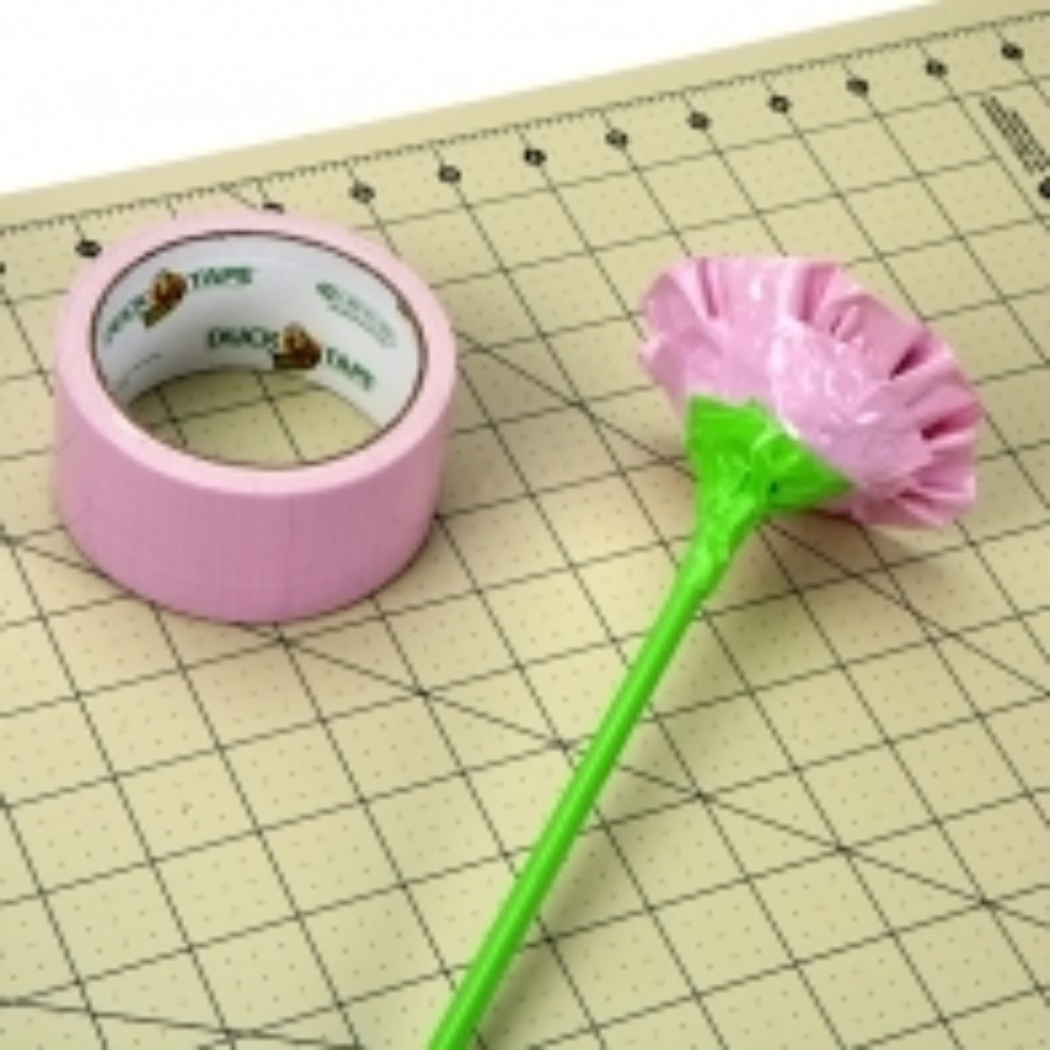 Dowel rod from step 1 taped to the bottom of the flower/egg to complete