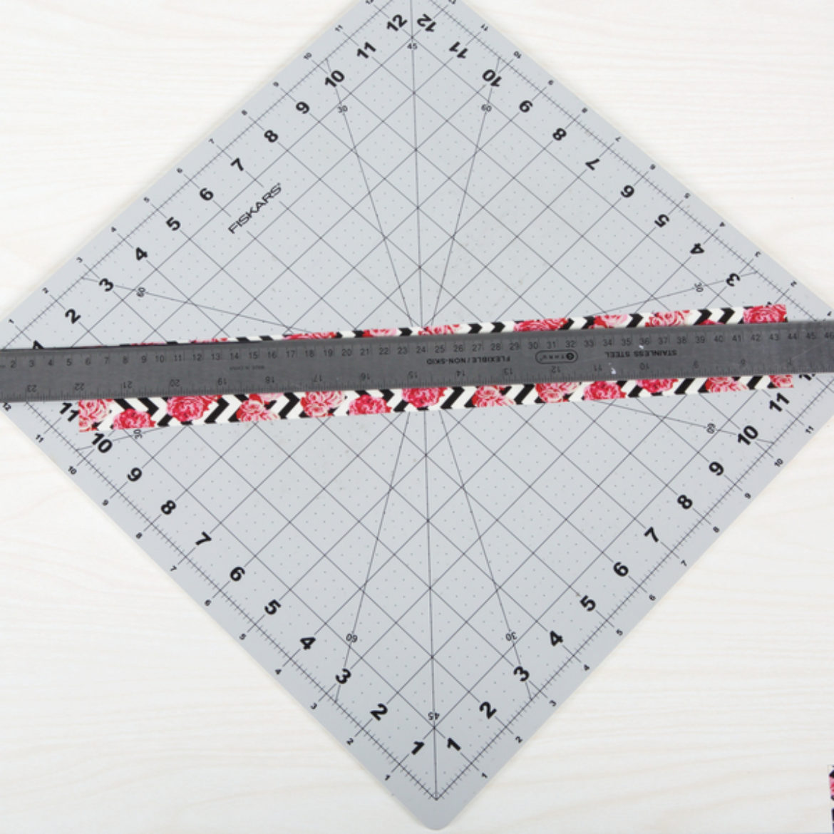 Long triangle from the Duck Tape strip from the previous step. Cut lengthwise from one corner to 1/3 of the way to the center of the strip so that you get two very long and skinny triangles