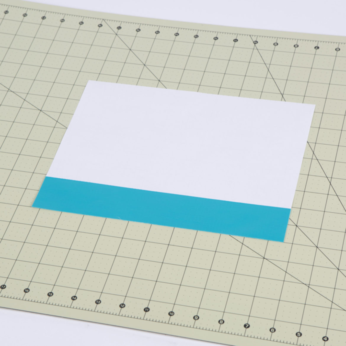 Small rectangular piece of poster board covered in Duck Tape without overlapping strips, so that you can cut them out later