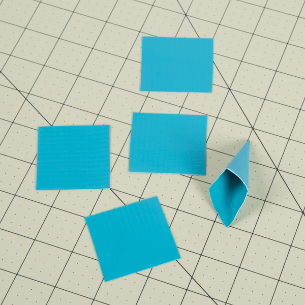 Squares from previous step folded into a cone shap and held in place with a small piece of tape