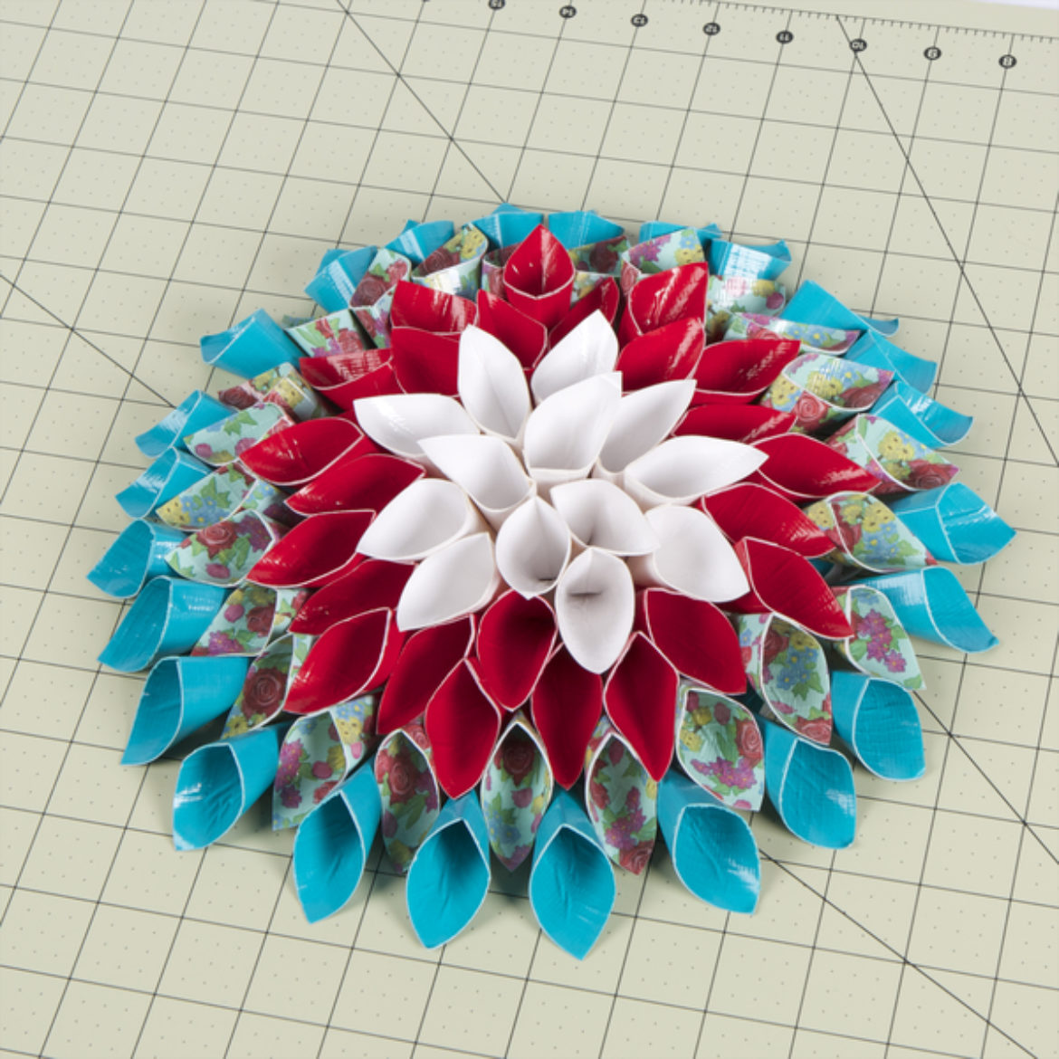 Steps 2-3 repeated until there are rings of cones attached to the circle so that it resembles a flower