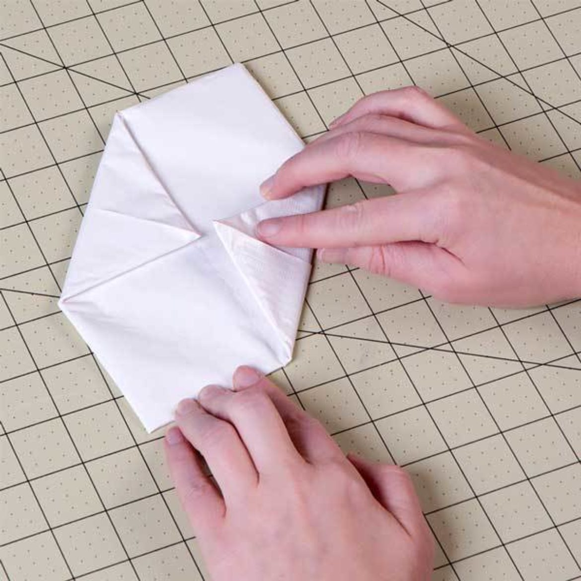 After flipping over, previous step is repeated to form a even smaller square