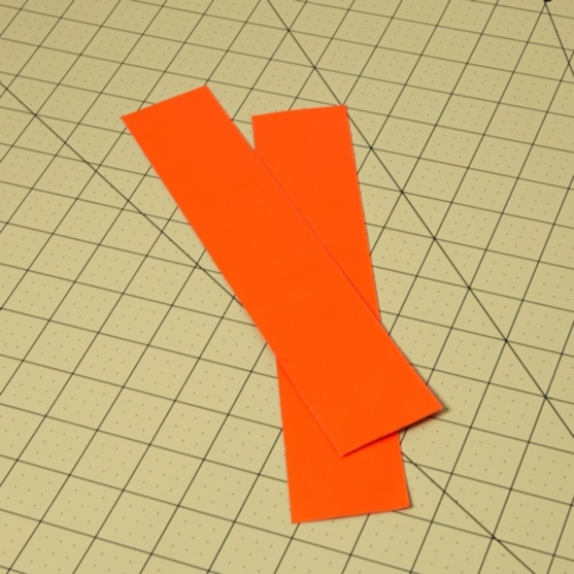 Two double sided Duck Tape strips