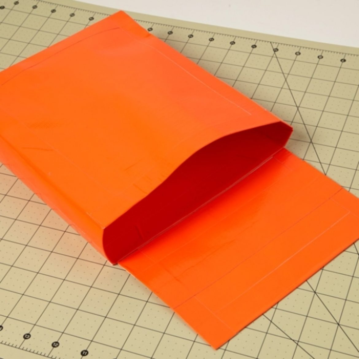 Fold all of the sides from the previous step together and secure with strips of Duck Tape