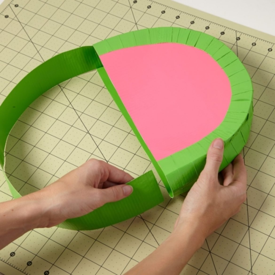 Double sided Duck Tape strip being attached to the bag to form a strap