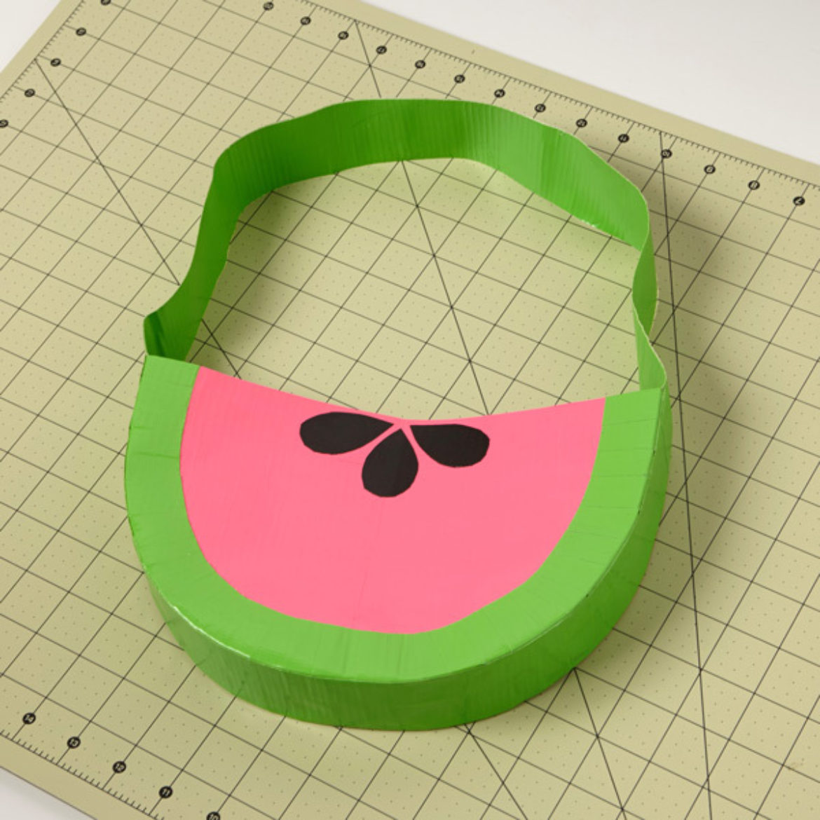 Finished Duck Tape fruit themed bag with the seeds from previous step attached
