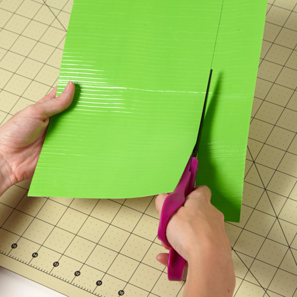 Duck Tape fabric being cut by scissors