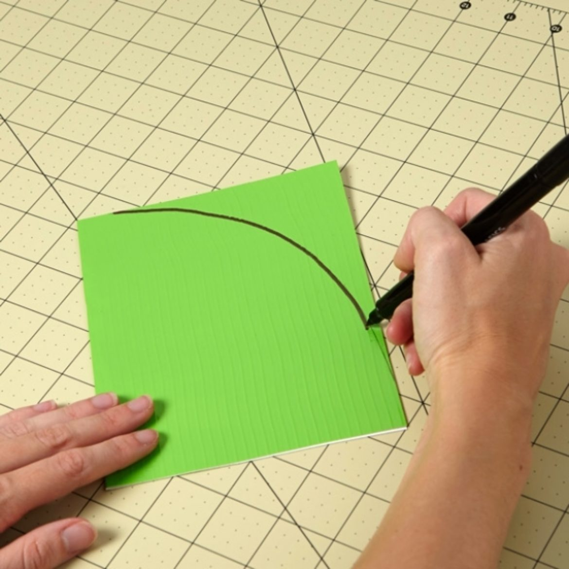 Curve being drawn on folded Duck Tape fabric