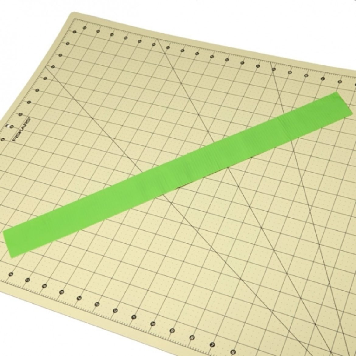 Strip of Duck Tape placed sticky side down on crafting board