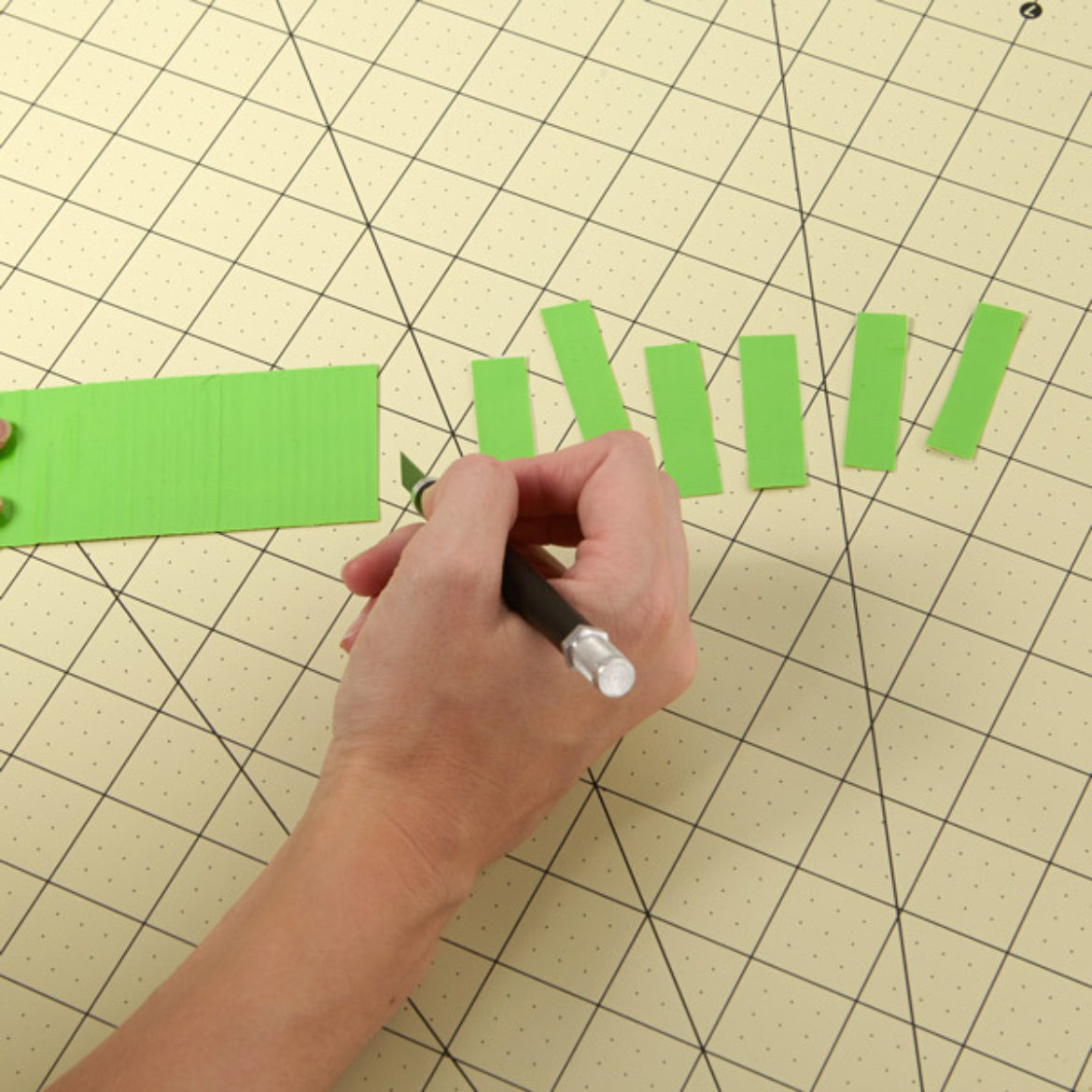 Strip of Duck Tape being cut cross-ways to create smaller strips