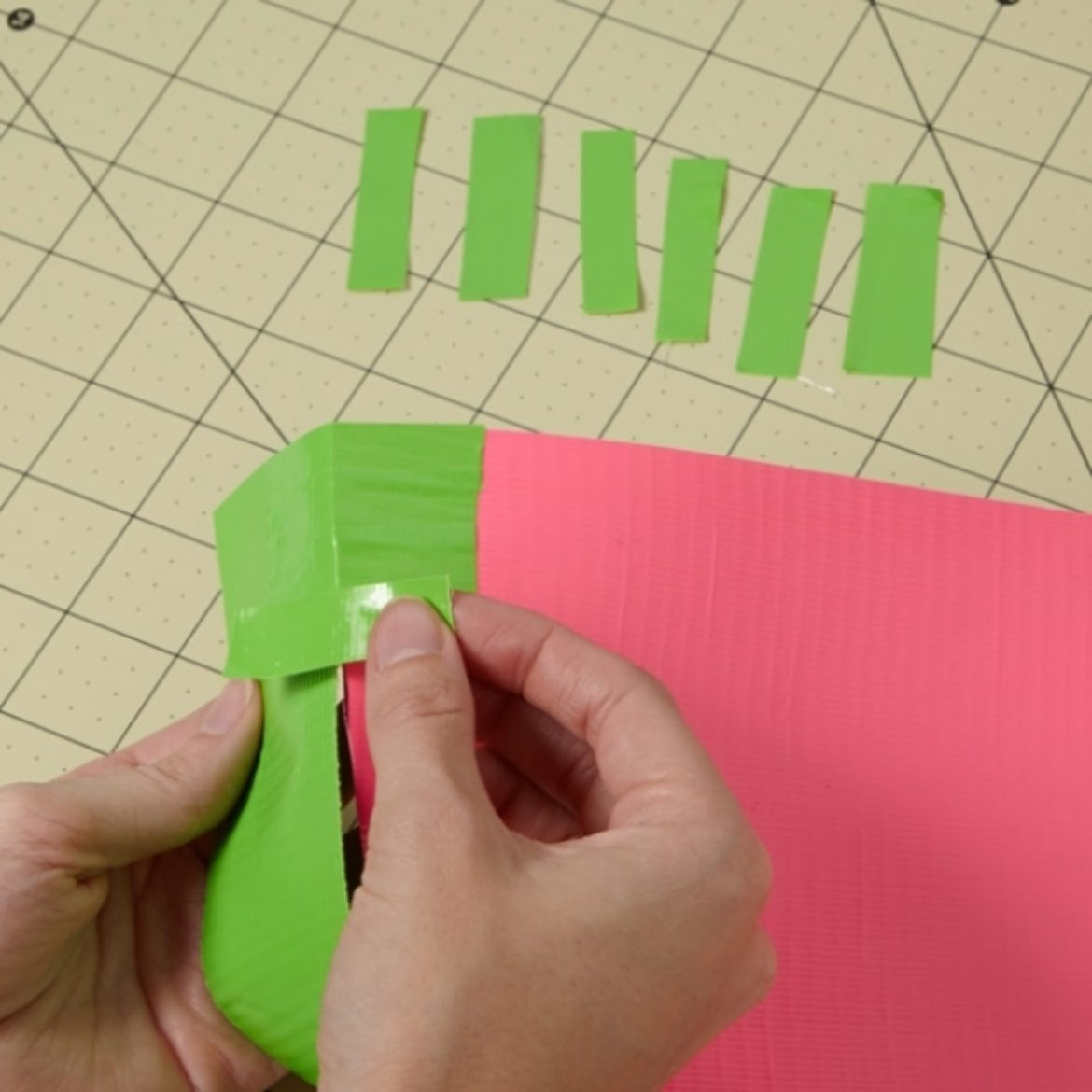 Small strips being used to attach the half circles to the double sided Duck Tape strip