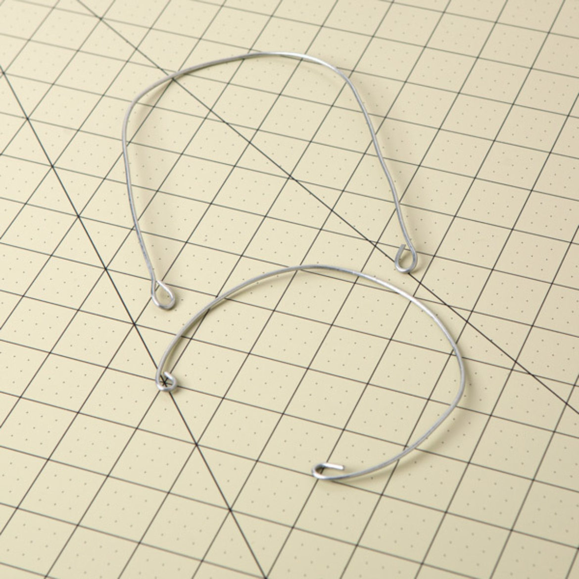 short wire bent into a u shape with loops on either end. Longer wire bent into a circular shape with the ends formed into loops