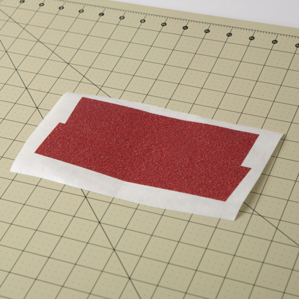 strips of Duck Glitter tape placed overlapping onto a piece of wax paper