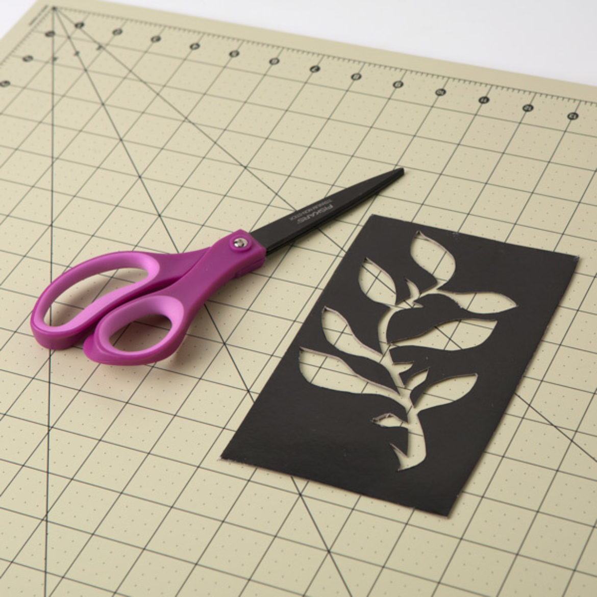 Floral design traced onto cardstock and cut out with scissors to serve as a template