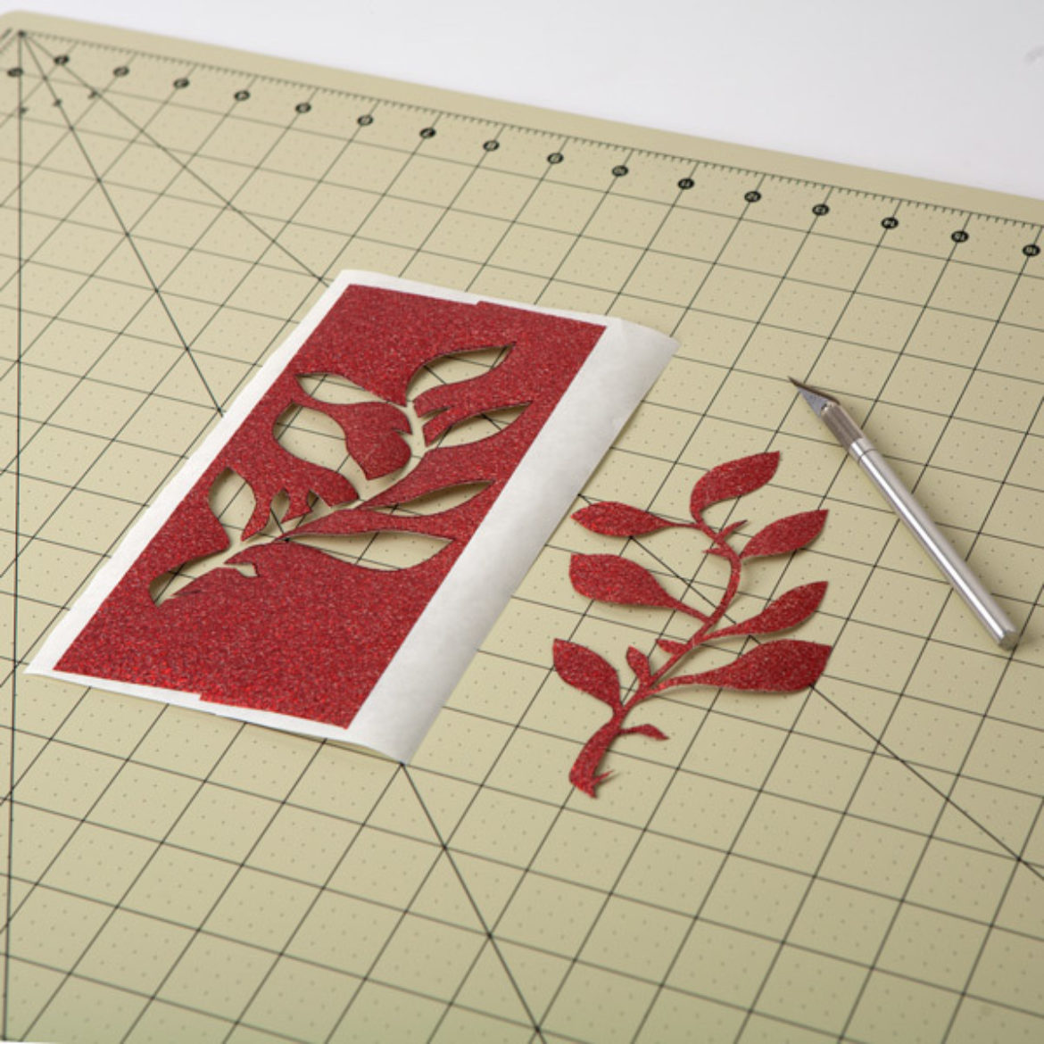 floral design traced in the previous step cut out using a craft knife