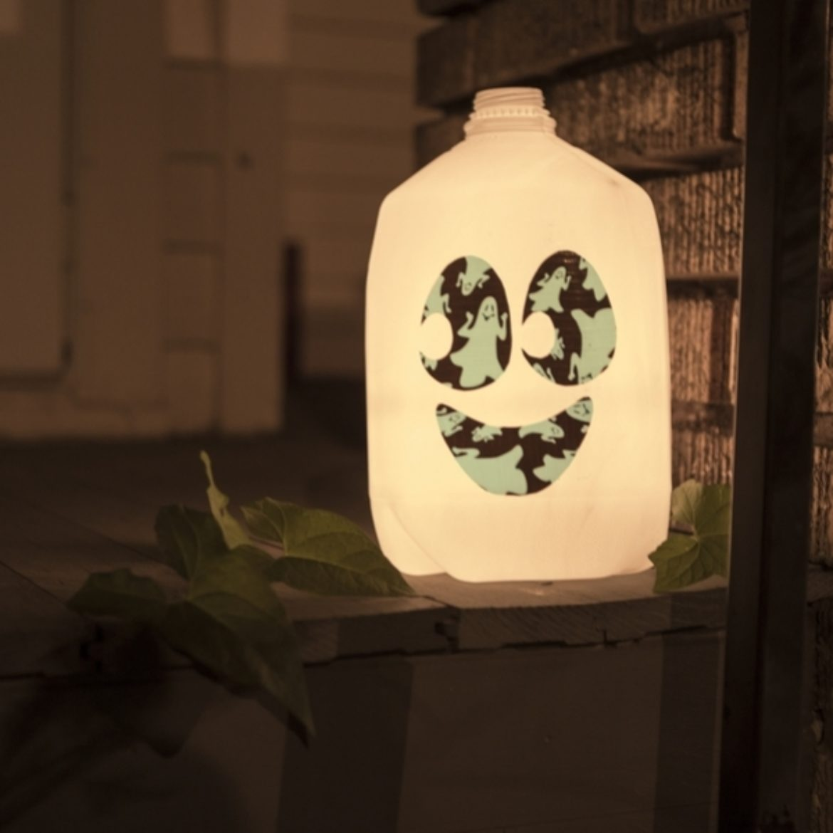 Completed Glow-in-the-Dark Duck Tape®Milk Jug Lantern with a small led light placed inside