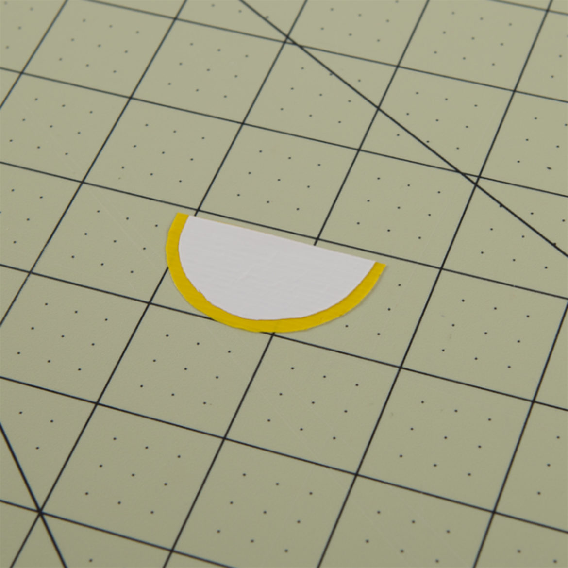 White semicircle from previous step placed over the yellow one
