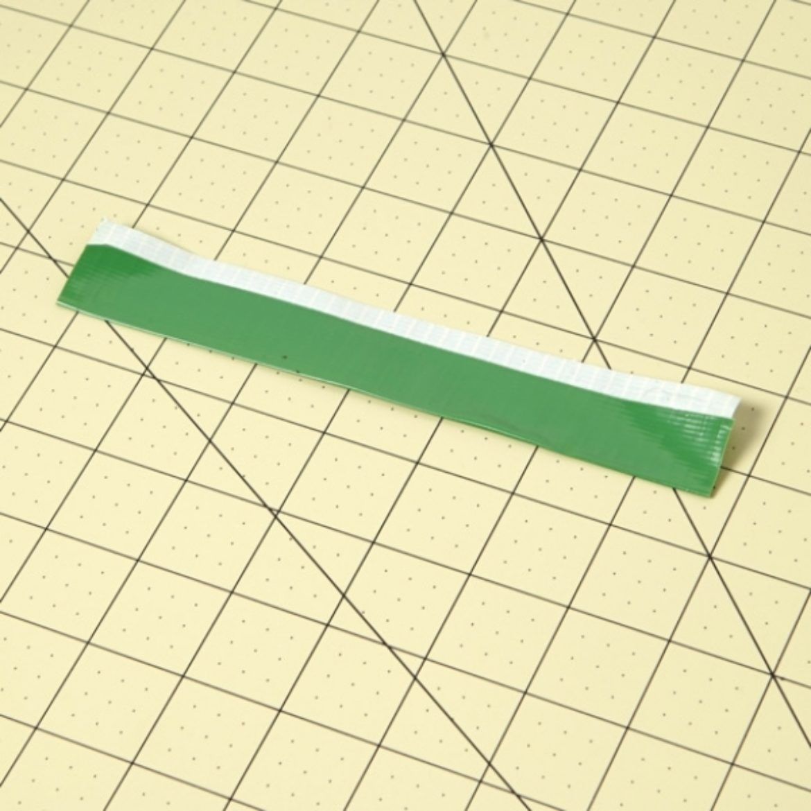 Strip of Duck Tape folded length wise so the there is a thin strip of sticky side exposed on one side