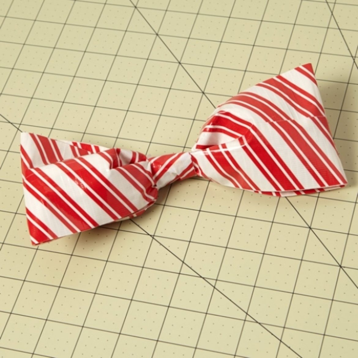 Bow fashioned from a loop of a doubled over strip of Duck Tape, secured tightly at the part where the two ends meet to create a bow tie shape