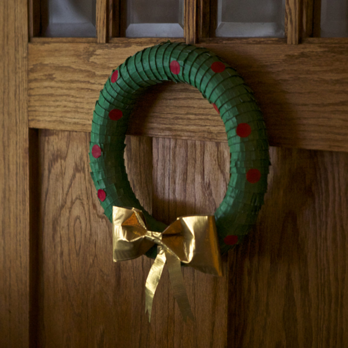 Completed  Duck Tape®Holiday Wreath hanging on a door