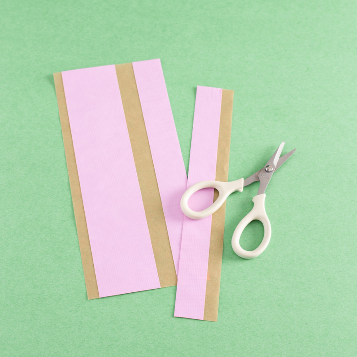 Strips of pink duct tape with scissors