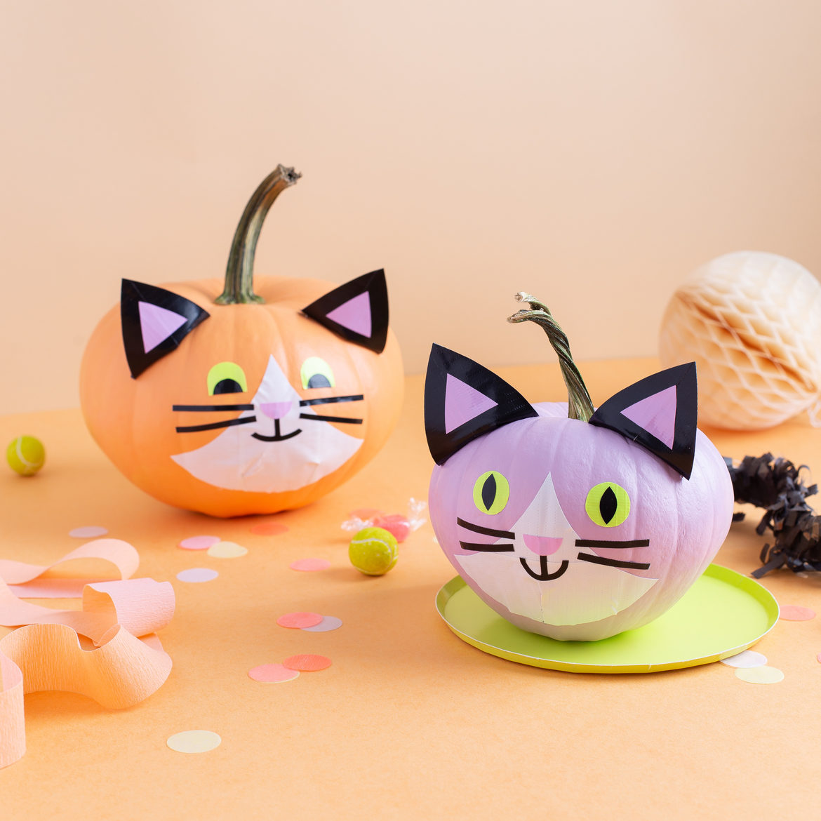 Colored cat pumpkins decorated with duct tape.