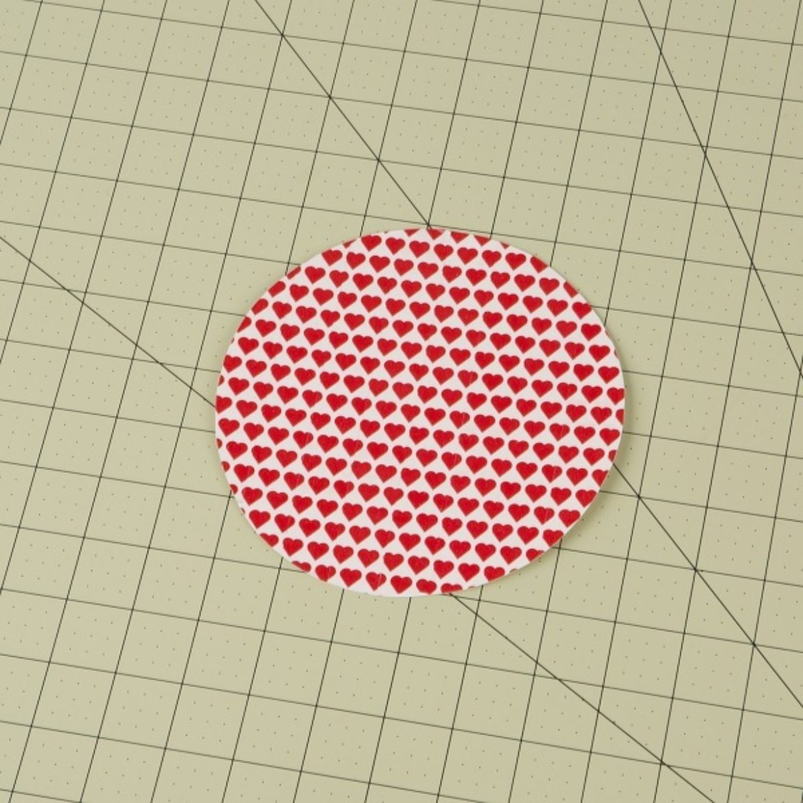 one of the circles from the previous step covered in Duck Washi Tape