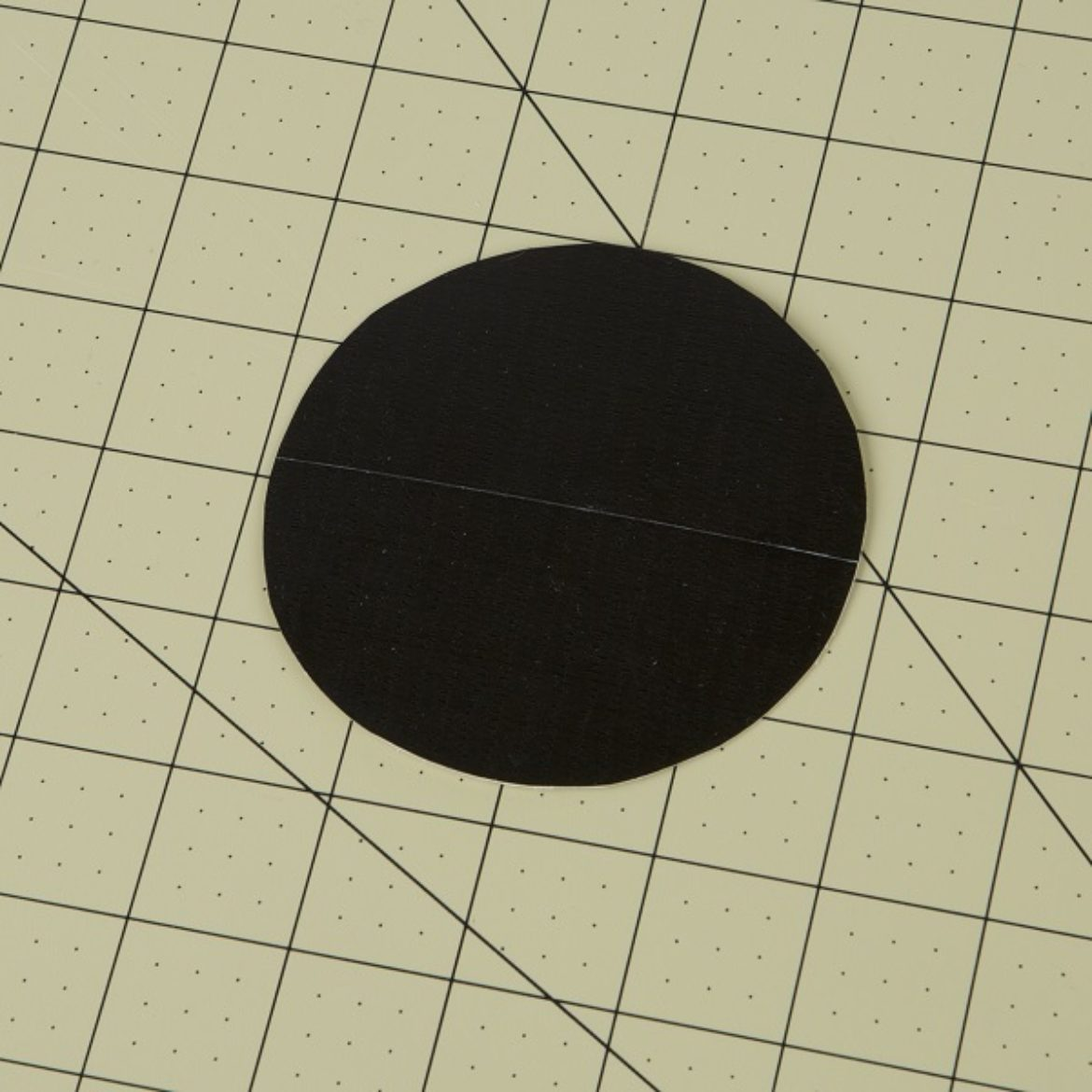 circle from the previous step covered in black Duck Tape