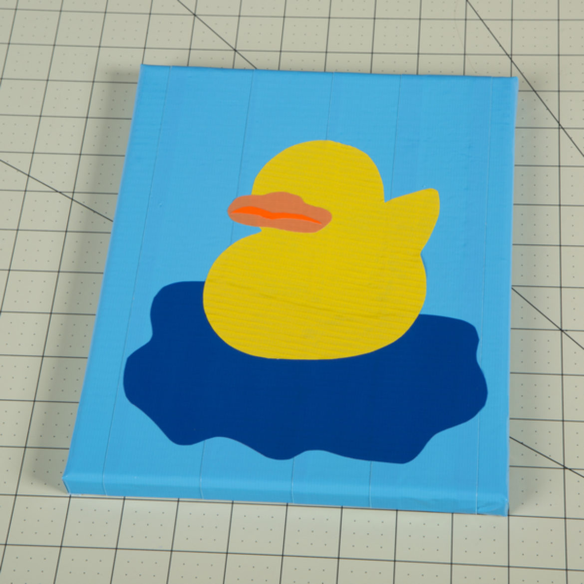 Beak shape form previous step traced and cut out of a piece of Duck Tape. Place on the Duck outline