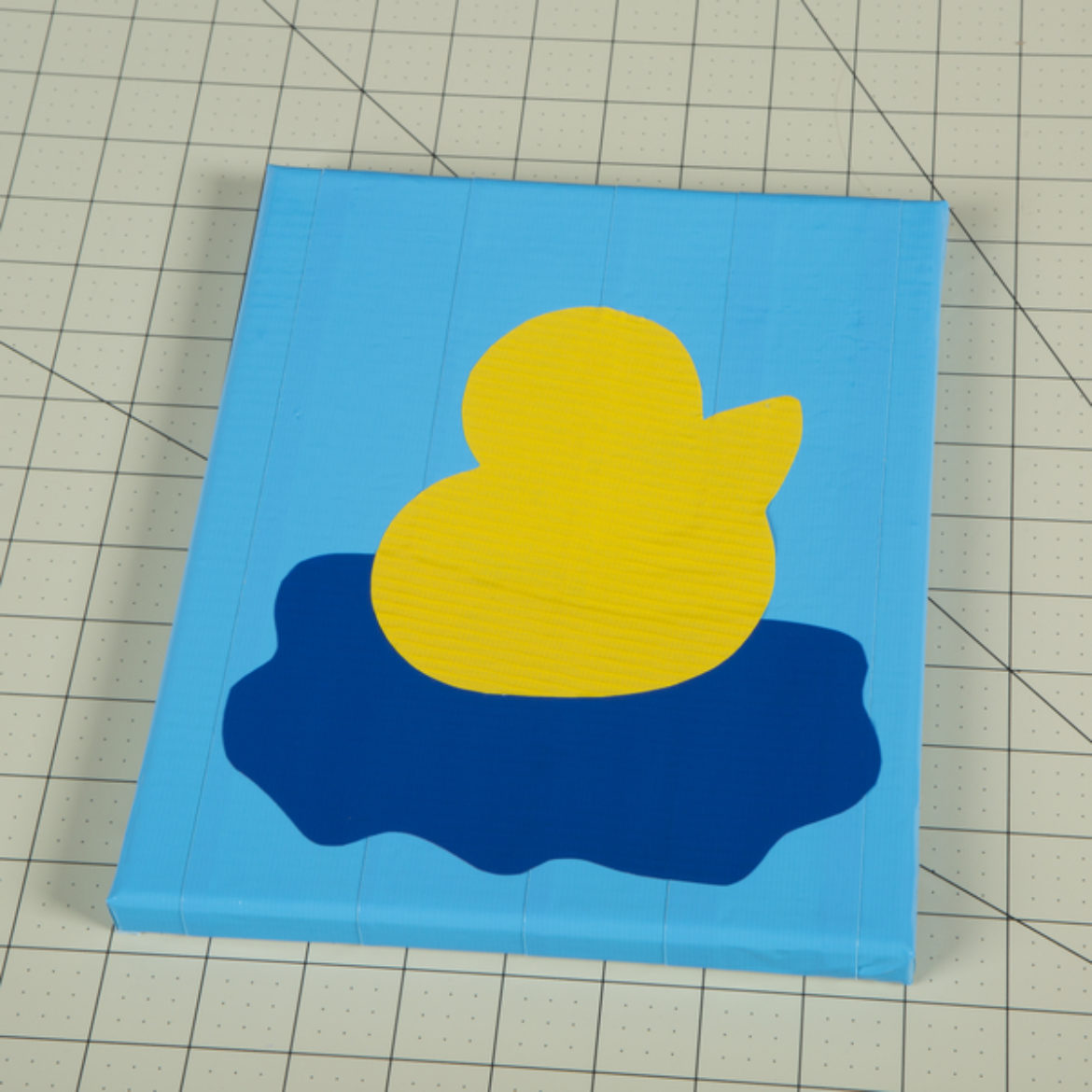 Duck outline placed on top of the the puddle piece from the previous step