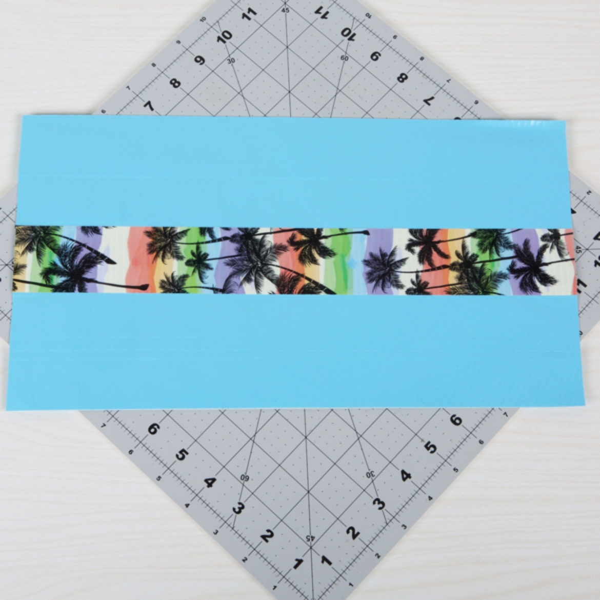 Design strip of Tape affixed to the center of the fabric