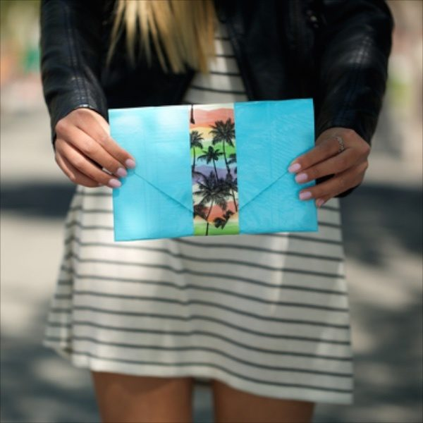 Woman holding a completed Duck Tape Magnetic Clutch