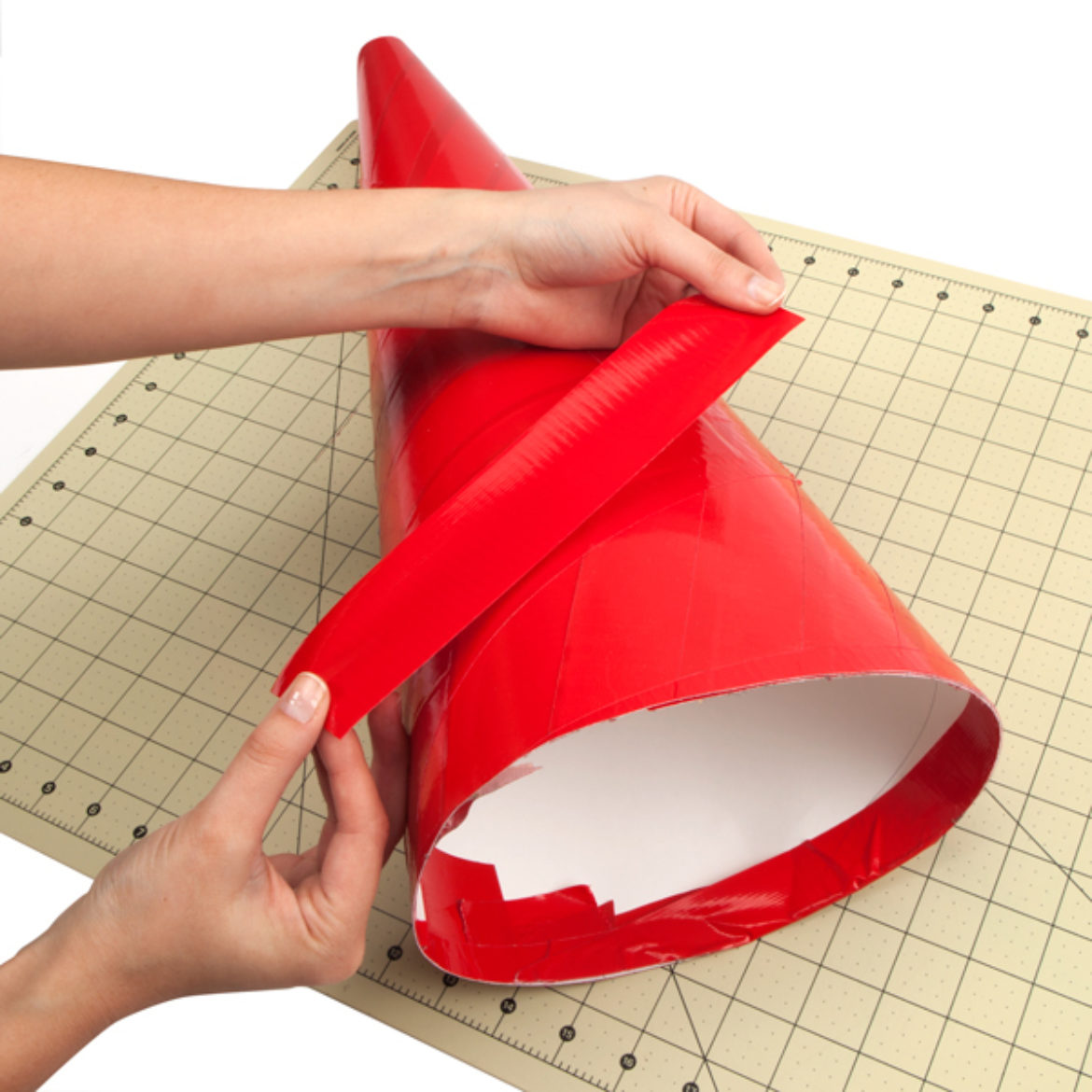 Poster board bent into the shape of a cone and held in place by a strip of Duck Tape