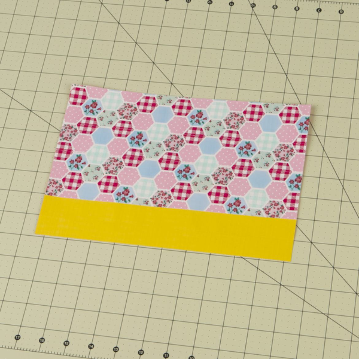 Duck Tape fabric with a strip of yellow Duck Tape at the bottom