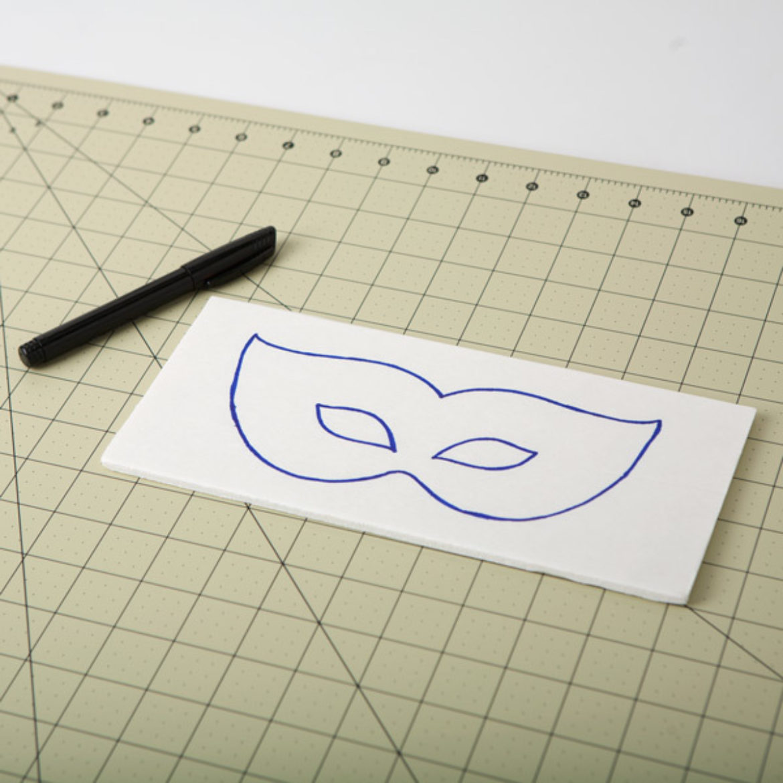 Mask shape drawn onto foam core board