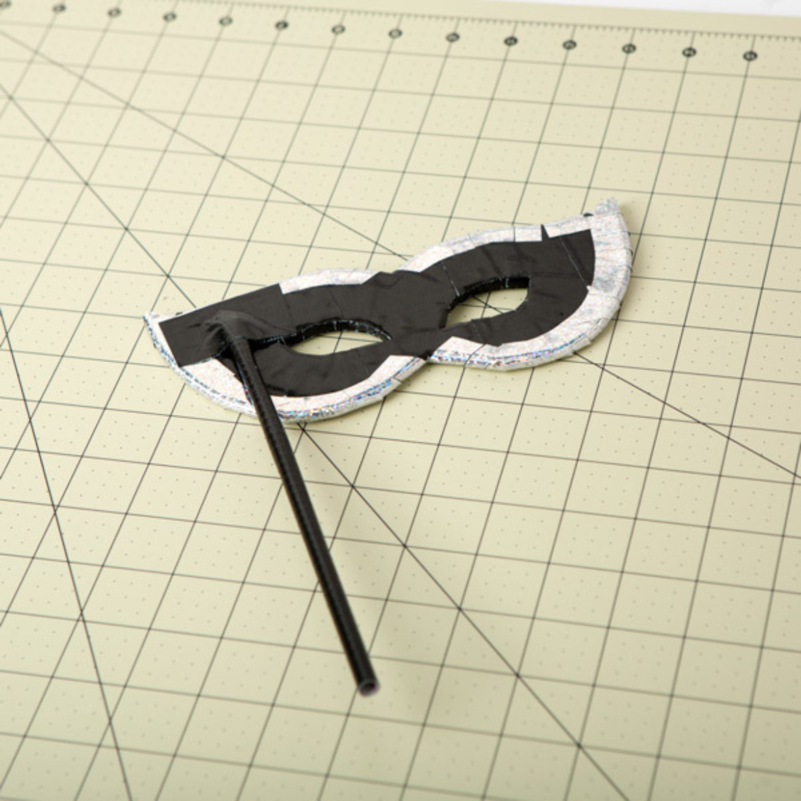 Straw from previous step attached to the back of the mask to serve as a handle