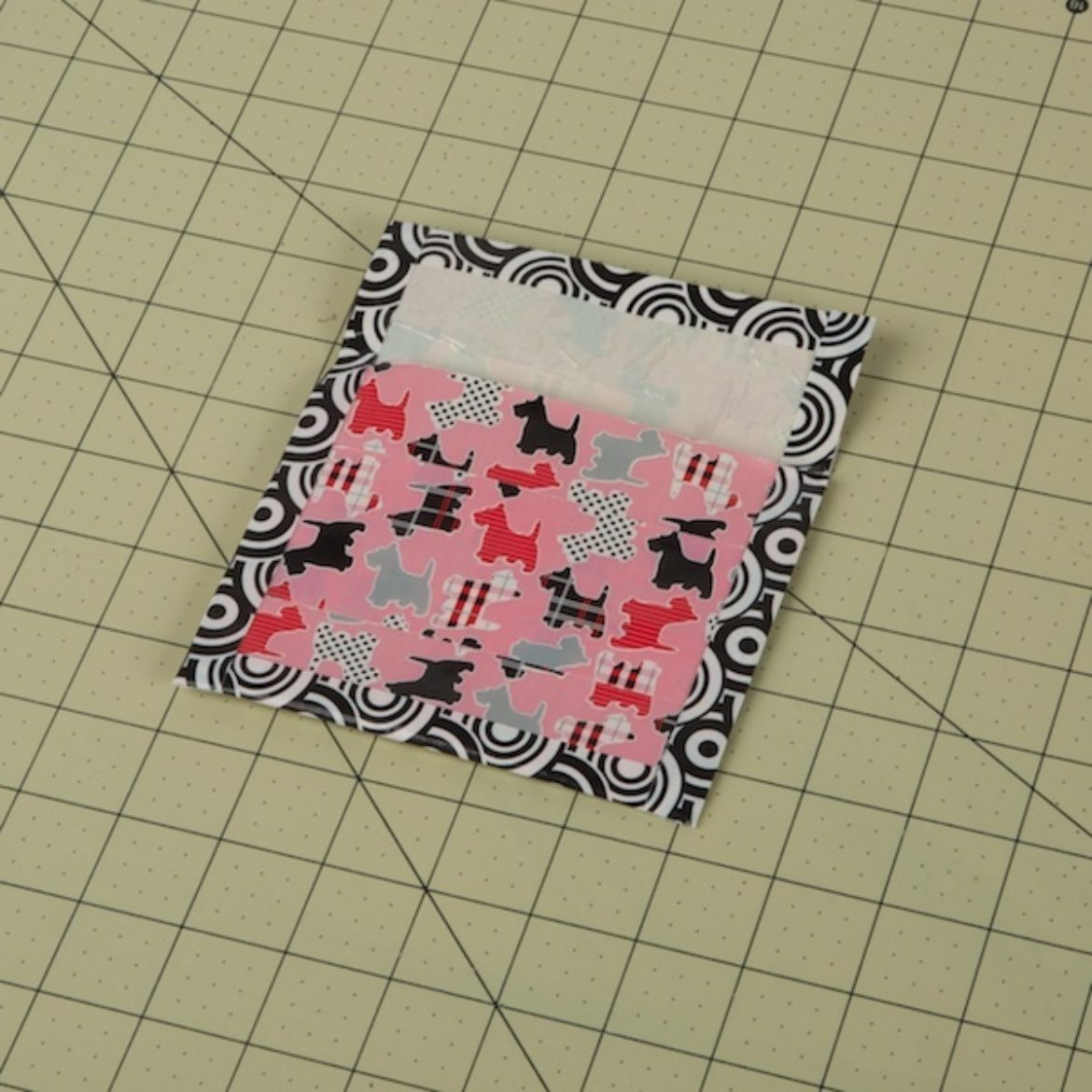 tape the sides of the main pouch to create a border