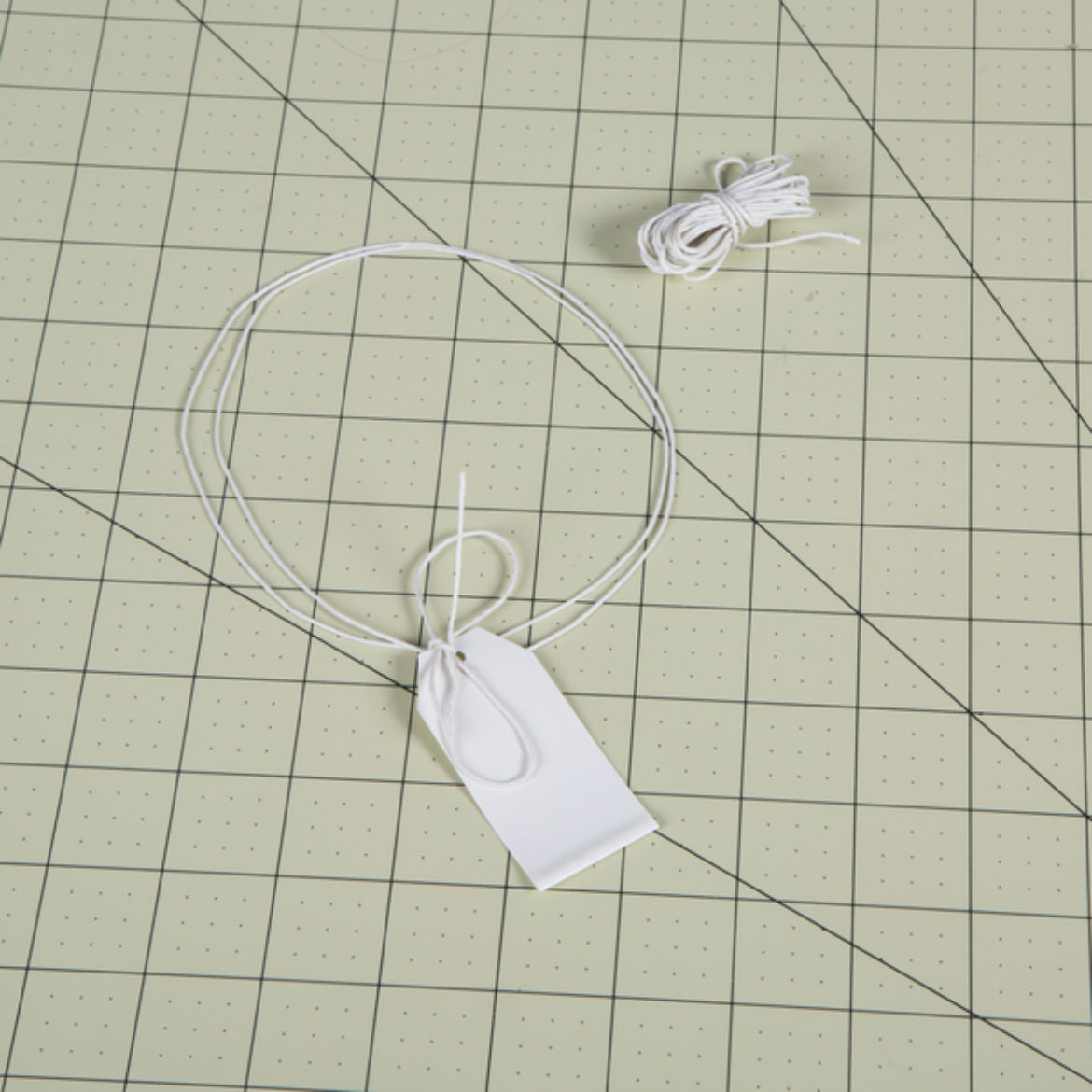 string running through a hole cut into the Duck Tape tag made in the previous step