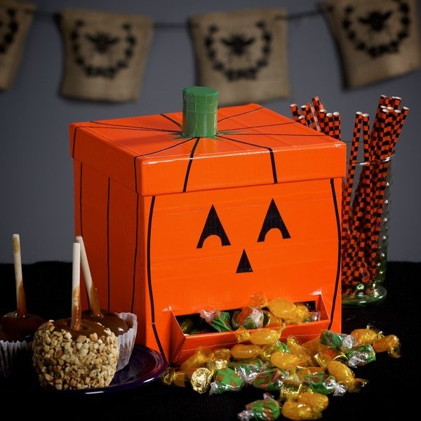 Completed Duck Tape®Pumpkin Candy Dispenser filled with candy