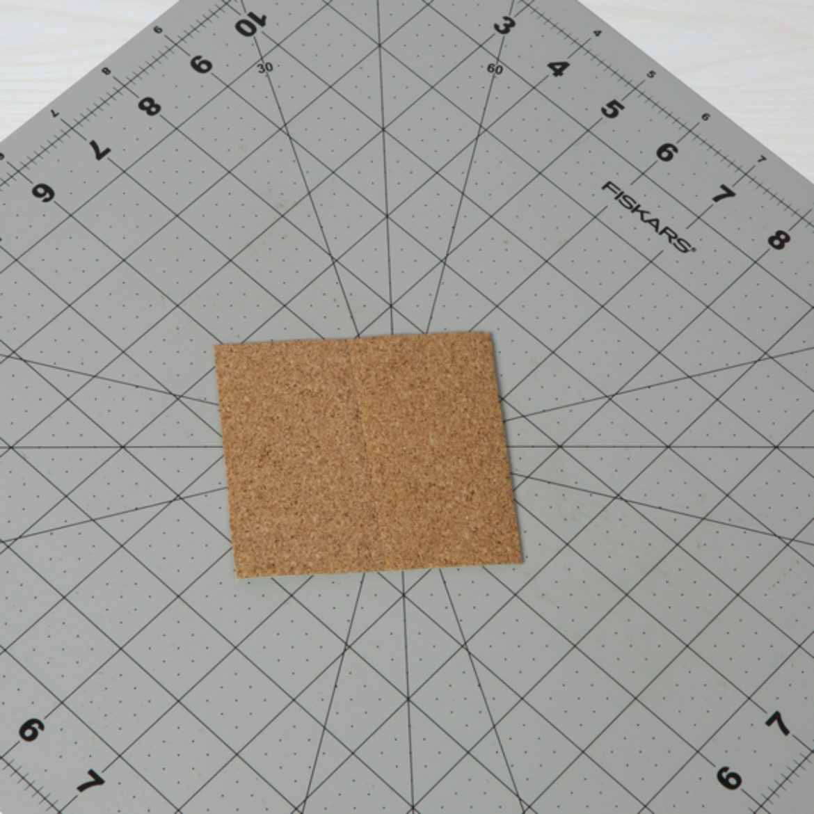 excess Duck Tape and Cork Tape trimmed off to form a square