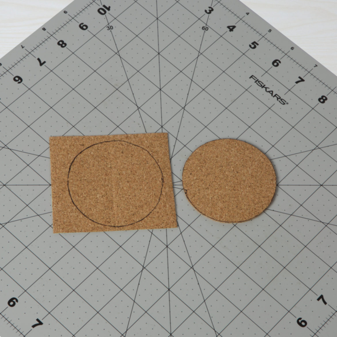 Circle drawn on the square from the previous step. Circle is then cut out.