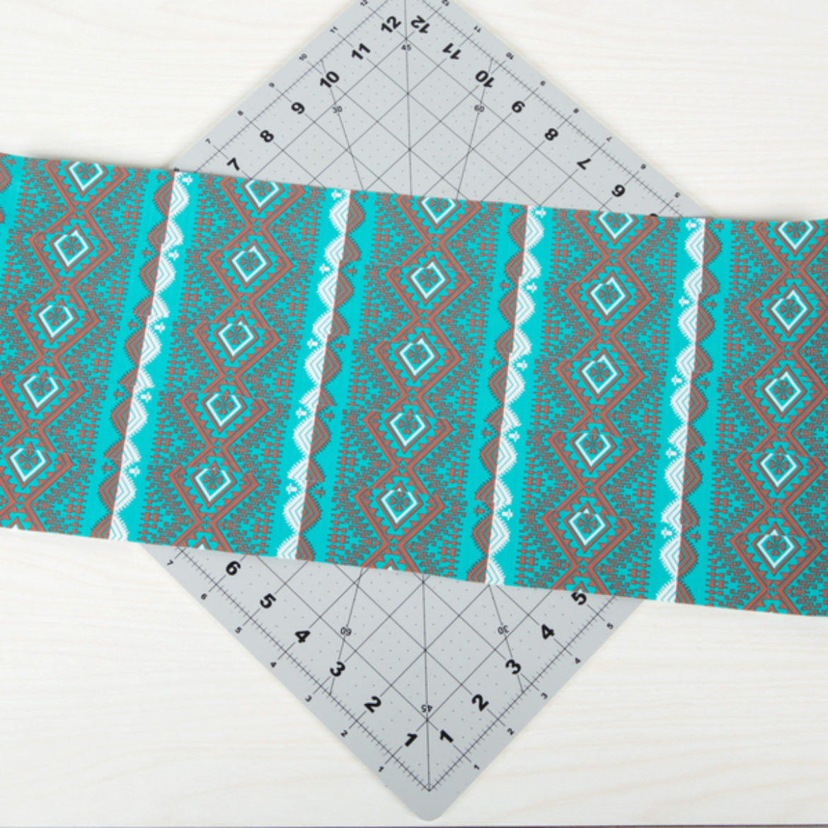 Double sided Duck Tape fabric made by overlapping strips of Duck Tape into a sheet and placing sticky side to sticky side with an identical sheet