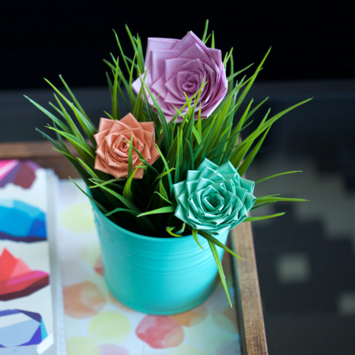 Finished Duck Tape®Roses in a planter example with grass inside