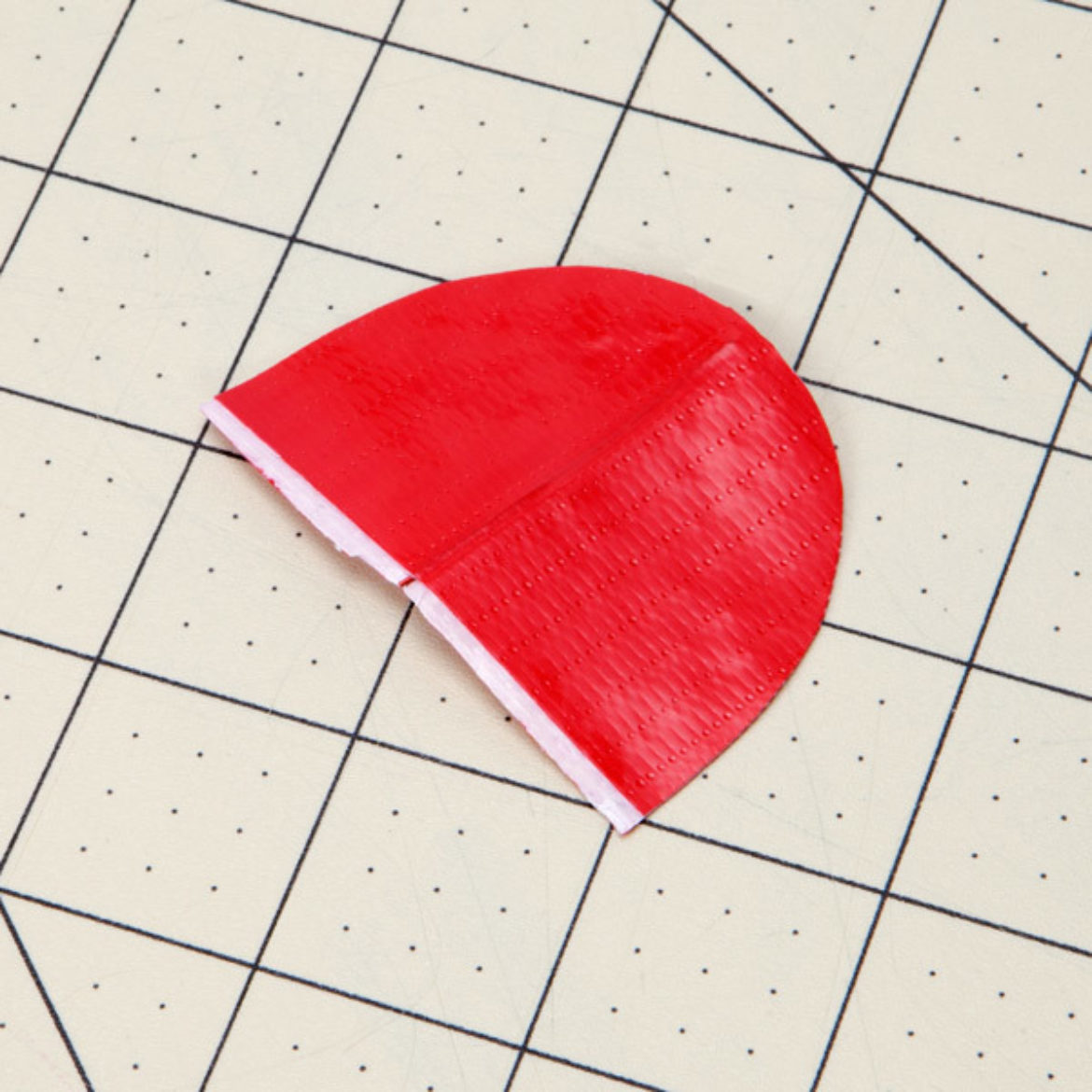 petal made in the previous step cut into a dome shape where the wire faces outward toward the top of the dome